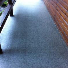 Coated sidewalk with added slip resistance for exterior sidewalk
